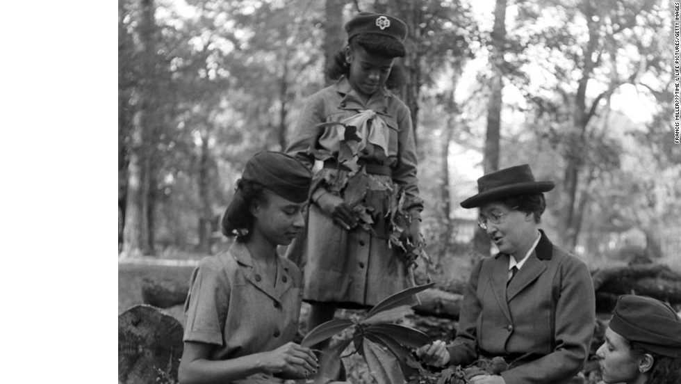 "Unpublished. ""The first Girl Scout,"" Daisy Gordon Lawrence, with young Scouts in 1948."