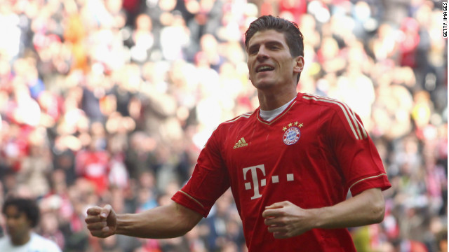 Mario Gomez celebrates his opening goal in Bayern Munich's 7-1 rout of Hoffenheim.