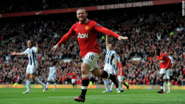 Wayne Rooney celebrates scoring the first of his two goals as Manchester United went top of the English Premier League.