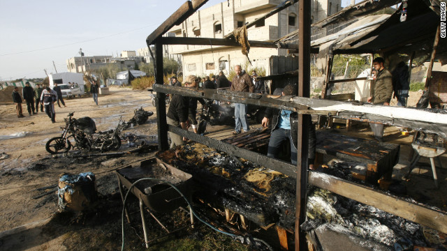 Palestinians inspect the damage at Rafah Refugee Camp after Israeli airstrikes on Saturday.