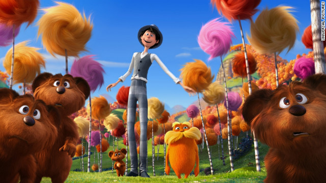 This photo of the 2012 animated film shows the orange character of Lorax in the center, surrounded by colorful truffles.