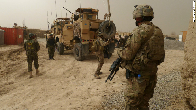 U.S. soldiers keep watch at the entrance of a military base near Alkozai village following the shooting of Afghan civilians allegedly committed by a U.S. soldier in Panjwayi district, Kandahar province on March 11, 2012.
