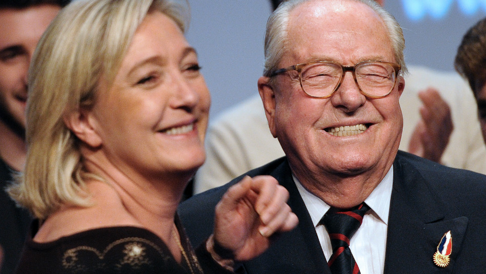 National Front Honorary President Jean-Marie Le Pen and his daughter Marine smile during the party's convention in Lille in February 2012.