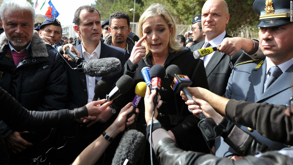 Marine Le Pen talks to the media outside a detention center for immigrants on the Italian island of Lampedusa on March 14, 2011.