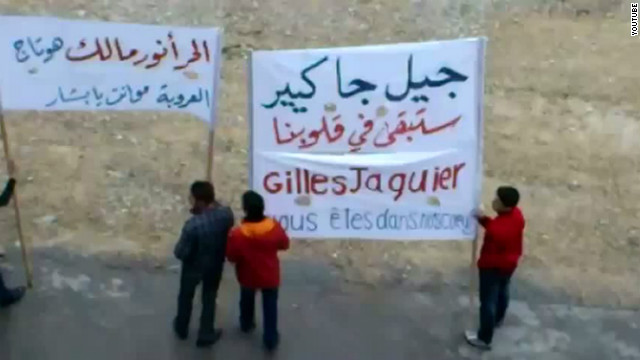 An image grab taken from a video posted on You Tube on January 13, 2012 shows anti-regime demonstrators in Damascus.