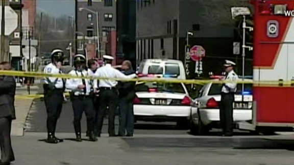 Columbus, Ohio, police confer at the scene of a multiple stabbing Wednesday. Police shot and wounded the suspect.