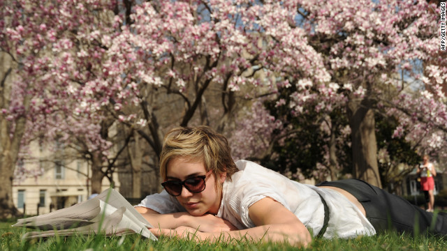 Zosia Sztykowski relaxes in Lafayette Park on a warm, sunny spring day in Washington, D.C.