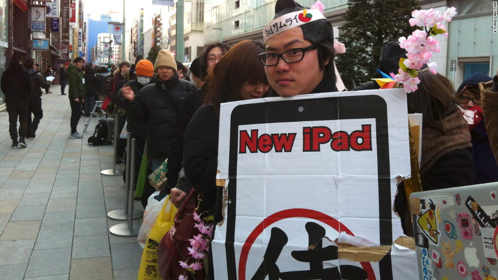 More than 300 people wait in an ordeerly line outside the Apple Store in Ginza, Japan.