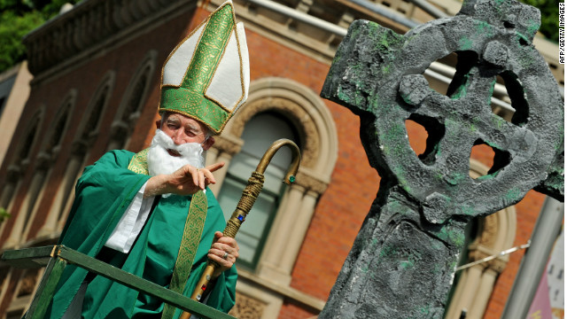 A man dressed as Saint Patrick waves to spectators during the 2010 Sydney St. Patrick's Day Parade.