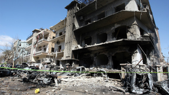 Green tape cordons off the scene following twin bomb attacks on security buildings in the Syrian capital Damascus on Saturday.