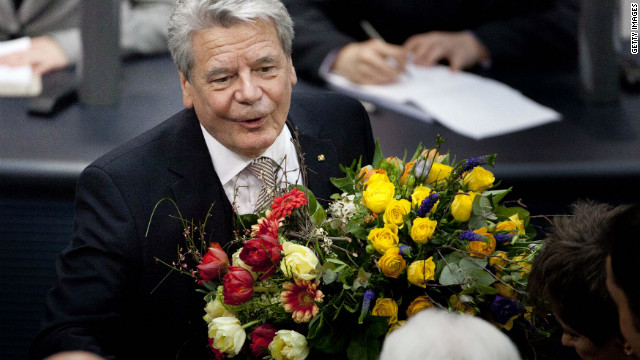 Joachim Gauck is congratulated by members of the Bundestag after being elected German president.