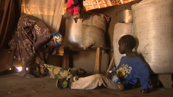 Grace Lagat ties up her seven-year-old son Thomas, who suffers from Nodding Disease, so he can