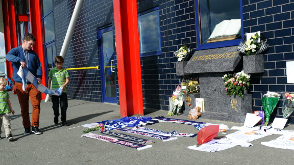 Bolton Wanderers fans have left flowers and scarves outside the English club