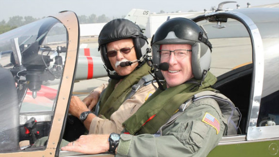 A participant prepares for take off next to their instructor at Air Combat USA.