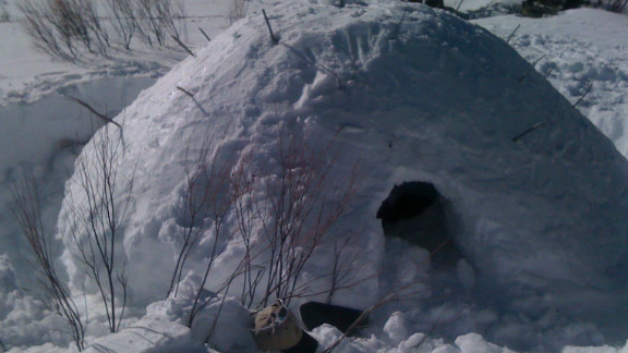 """A """"quinzhee"""" snow shelter prepared by a corporate participant on a """"Deep Snow Survival"""" retreat in the San Juan range in the Rocky Mountains."""