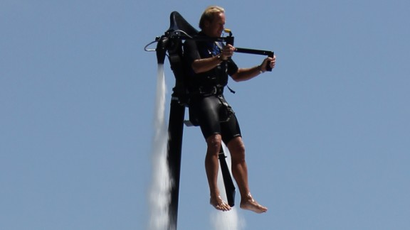 """A man tries out the Jetlev water jet pack. First-time """"flyers"""" can reach up to 15 feet; the jet pack can propel flyers a maximum of 30 feet high."""