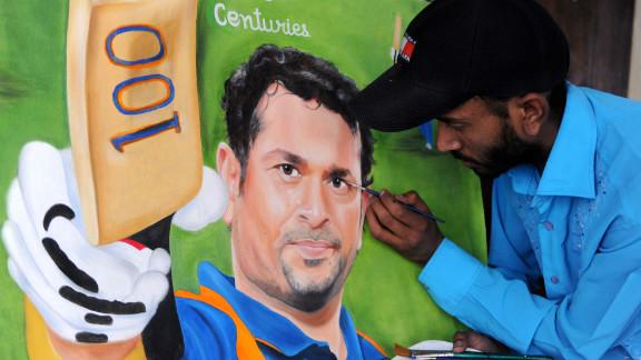 Indian painter Jagjot Singh Rubal touches up his painting of Tendulkar.