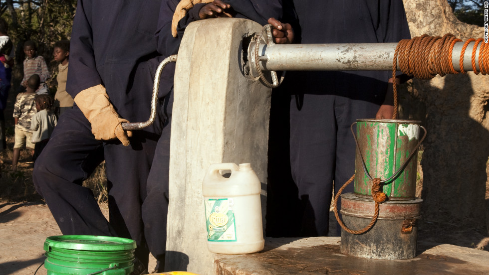 Local artisans show off a newly completed well in Mambwe village in Zambia.