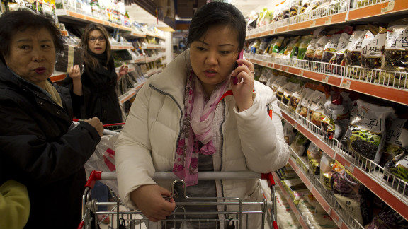 JinHye Han talks on her cell phone as she looks through the aisles at the local Korean grocery.