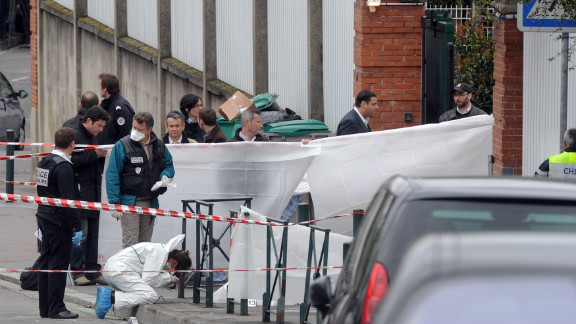 Investigators work at the Jewish school in Toulouse, France, where four people were killed and two seriously wounded Monday.