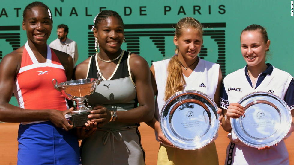 Venus won her first Grand Slam title at the 1999 French Open, winning the doubles tournament with her sister, Serena. From left are Venus, Serena, Anna Kournikova and Hingis. The Williams sisters have had wildly successful singles careers, but they've also been a force as a team, winning 14 Grand Slam titles and three Olympic gold medals. Venus has also won two Grand Slams in mixed doubles.