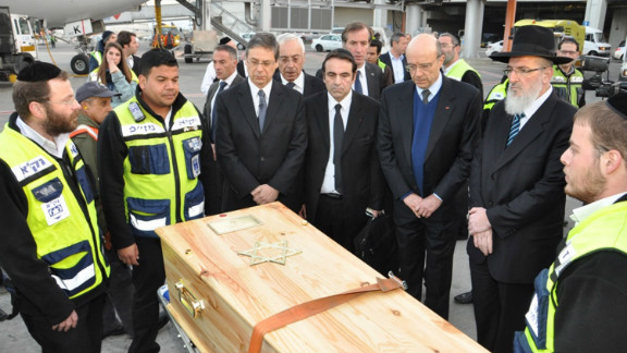 The coffins containing the bodies of the victims of the shooting at the Ozar Hatorah Jewish school arrive at Ben Gurion Airport, Israel from France on March 20. They were buried in Jerusalem on Wednesday.