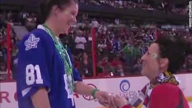 Lesbian marriage proposal at hockey game