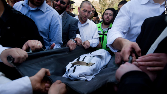 Relatives and other mourners in Jerusalem carry the body of one of the four victims of the Toulouse, France, school shooting.