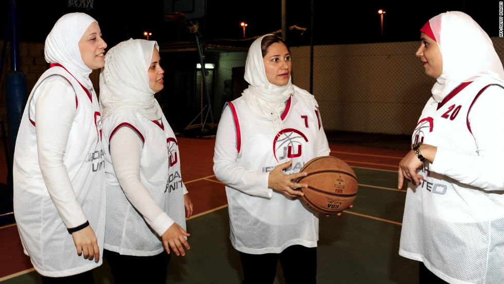 """We are trying to make it on a national level, integrate into public schools and then maybe compete on a regional level before we even think of the Olympics,"" says Lina Al-Maeena (center), captain of the Saudi women's basketball team."