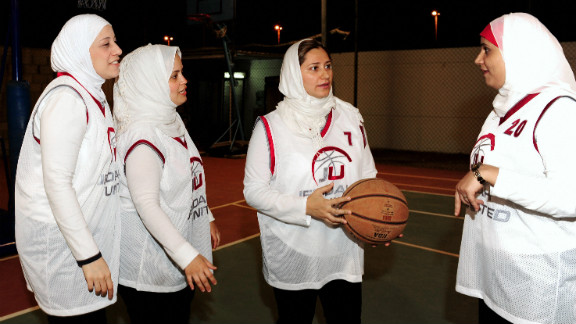 """""""We are trying to make it on a national level, integrate into public schools and then maybe compete on a regional level before we even think of the Olympics,"""" says Lina Al-Maeena (center), captain of the Saudi women's basketball team."""