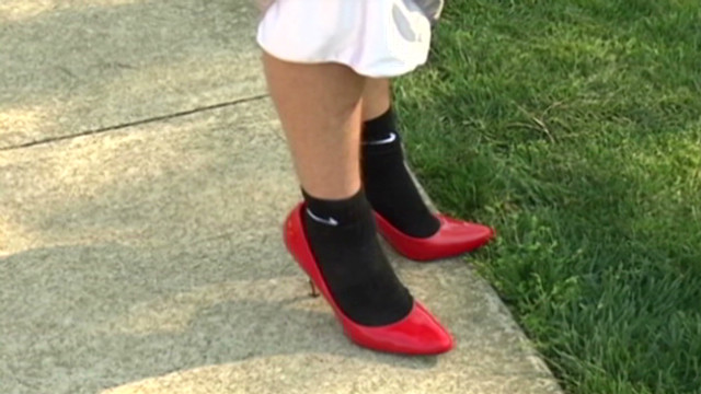 College men walk a mile in high heels