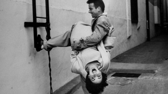"""Elizabeth Taylor jokes around with co-star Montgomery Clift on the set of """"A Place in the Sun"""" in 1950. Taylor was born 82 years ago on February 27, 1932, and Life.com published these photos in 2012 to remember the late actress. Photographer Peter Stackpole was able to capture the unique bond the young actors shared."""