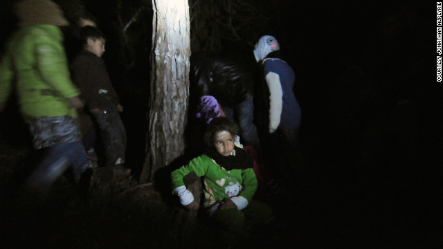 A Syrian boy escapes at night with his family from their hiding place, making for the Turkish border.