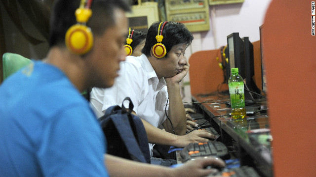 Local residents use the computers at an Internet bar in Beijing on September 8, 2011.