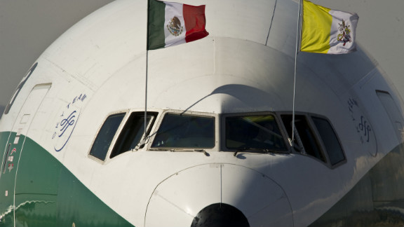 The airplane carrying Pope Benedict XVI, decorated with Mexican and Vatican flags, arrives on Saturday at Silao's international airport.