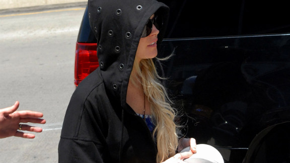 Actress Lindsay Lohan arrives at Los Angeles International Airport in a hoodie in August 2009.