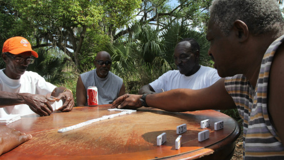 Members of the Goldsboro community play a game under an oak tree. Goldsboro was one of Florida