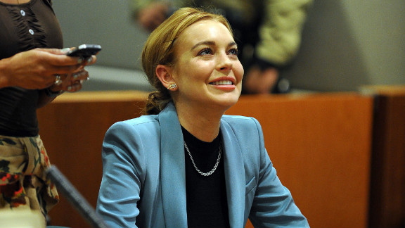 Lindsay Lohan attends her probation hearing with attorney Shawn Chapman Holley (L) at the Airport Courthouse on March 29, 2012 in Los Angeles, California.