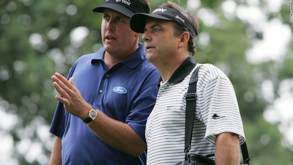 Haney defended himself from criticism by Phil Mickelson's former coach Rick Smith, right, who said the book violated traditional trust in such a relationship.