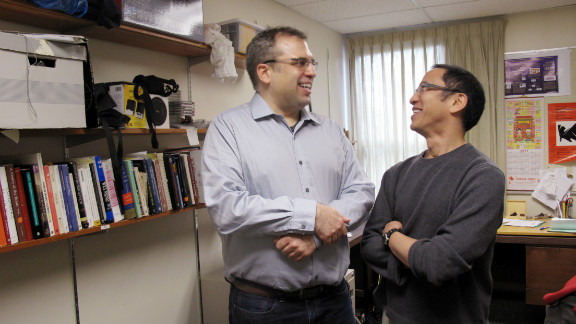 Joseph Sheppard, left, talks with psychology professor Jim Tanaka. The two direct an autism research center at the University of Victoria.
