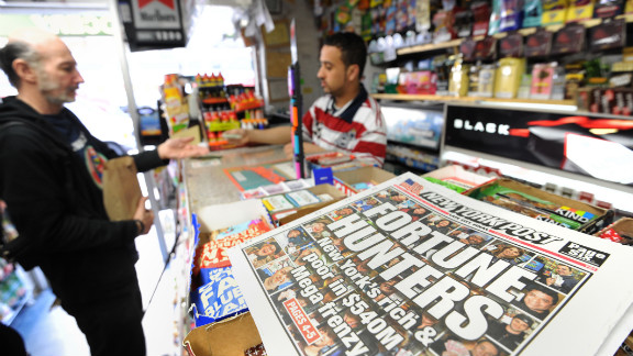 A New York Post headline touts the Mega Millions lottery as tickets are sold at a convenience store on the east side of Manhattan on Friday. No one has matched the magic five numbers and Mega Ball since January 24 -- a full 18 drawings with no winner. Given the pace of ticket buying, the jackpot will go even higher before the drawing.