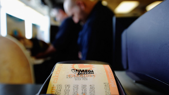 A Mega Millions ticket is printed out at Bluebird liquor store on Thursday. The store has a reputation for selling winning tickets, even though their last big jackpot ticket was sold a decade ago, before Mega Millions came to California, according to owner James Kim.