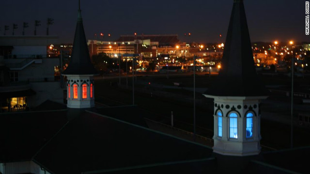 One of Churchill Downs' iconic Twin Spires was lit red for Louisville, the other blue for Kentucky