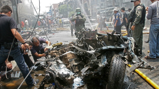 Thai military inspect wreckage from a bomb blast in the southern province of  Yala in this file pic from March, 2012.