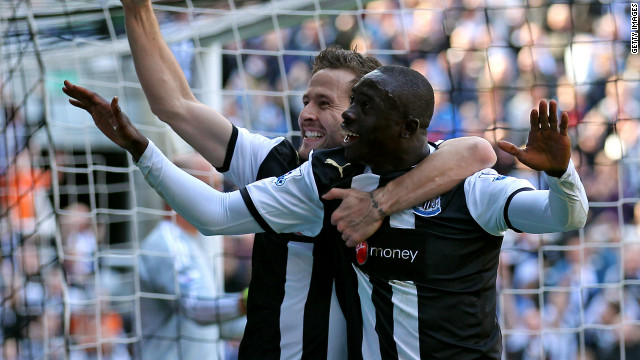 Papiss Cisse celebrates scoring twice for Newcastle in their 2-0 win over 10-man Liverpool.
