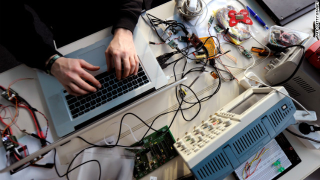 FILES - Picture taken on December 27, 2010 in Berlin shows a member of the Chaos Computer Club (CCC) working on his laptop. The German interior ministry promised on October 10, 2011 to clear up an affair about a spy software used by its authorities. A Trojan used by German investigative authorities and leaked to the CCC hackers organisation passes legal limits, the association said. AFP PHOTO TIM BRAKEMEIER GERMANY OUT (Photo credit should read TIM BRAKEMEIER/AFP/Getty Images)