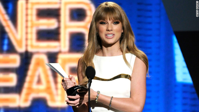 Singer Taylor Swift accepts the Entertainer Of The Year Award onstage at the 47th Annual Academy Of Country Music Awards Sunday night in Las Vegas.
