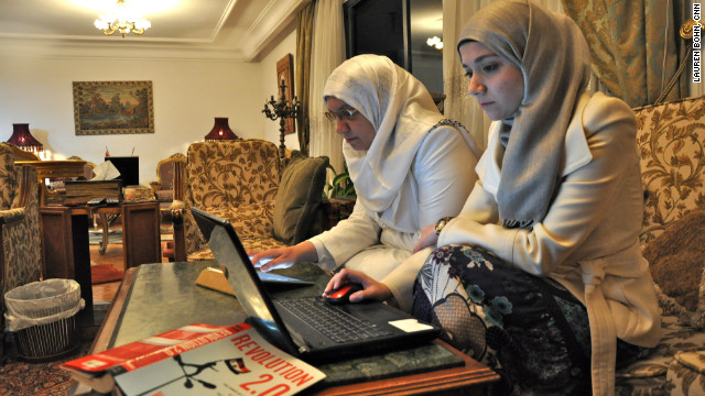 Sondos Asem, right, and her mother, Manal Abu Hassan, use social media in their Cairo living room