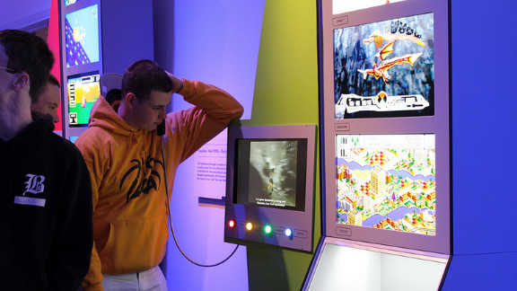 Twenty video game consoles from the past 40 years are on display in the exhibit. Each console features four games for that device that fans selected as being representatives for that stage in video game evolution.