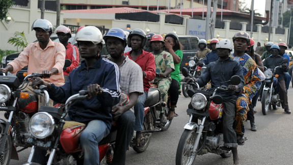 """Riding a motorcycle taxi, also known as """"okada,"""" is one of the ways to get around Lagos."""